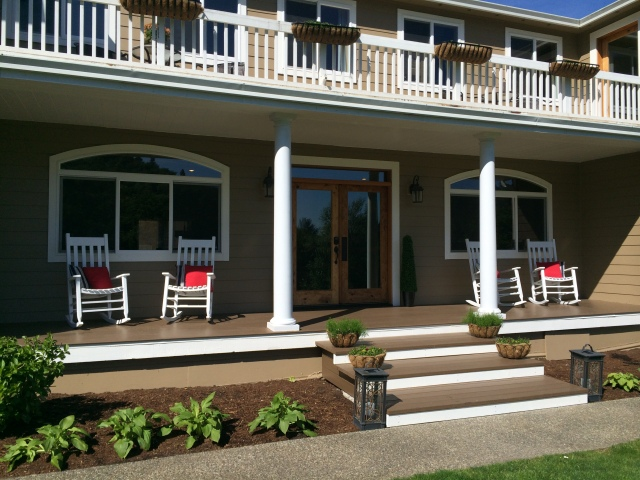 My front porch with a touch of the south...white rocking chairs